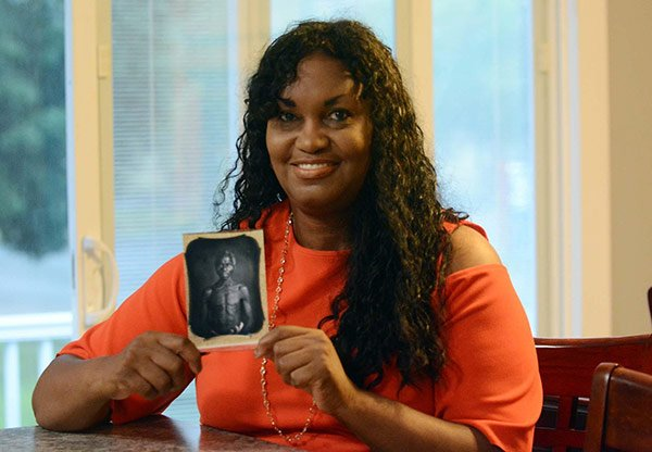 Tamara Lanier with a photo of Renty Taylor