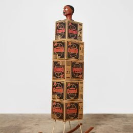 "Image Credit: Henry Taylor, Rock It, (2008). 5 cardboard boxes (premium malt boxes), acrylic on foam mannequin head, wood) 36"" x 12"" x 80 1/2"". © Henry Taylor"